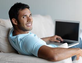 Gay single man on laptop